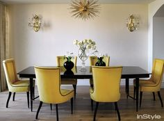 """Conrad's vintage dining room table and chairs play off the contemporary brass light fixture she was charmed by. """"It looked like a sea anemone to me!"""""""