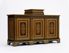 Cabinet by George Bullock, maple and ebony veneer, with marquetry of maple on an ebony ground; carcase of mahogany, pine and oak. London, 1817.