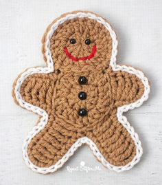 Here is a slightly bigger, updated version to my Crochet Gingerbread Man Cookie Pattern! I figured if I made this guy a little sturdier, he could be used for more decor… like on a wreath, strung as ga