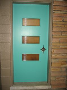 Hi Pam, finally a photo I'm not embarrassed of! My front door is solid hardrock maple with original turquoise paint and starburst hardware. Have a new satin nickel kickplate coming soon as well. Glass panels are reeded glass. Cheers! Jeff