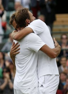 Jerzy Janowicz of Poland, right, embraces Lukasz Kubot of Poland after winning their Men's singles quarterfinal match at the All England Lawn Tennis Championships in Wimbledon, London, Wednesday, July 3, 2013. (AP Photo)