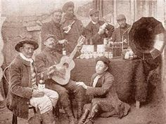 Miners near La Paz, Bolivia, with a cylinder phonograph, 1911.