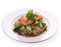 Teriyaki salmon soba - Wagamama Grilled salmon on a bed of teppan-fried noodles with pak choi, red onions, mangetout, beansprouts and chilli. garnished with teriyaki sauce, sesame seeds and coriander