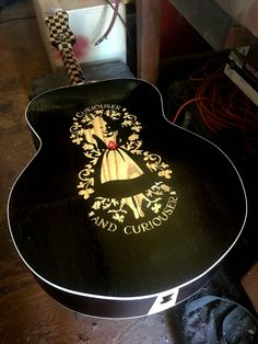 Custom inlay on the obverse of the Alice in Wonderland themed guitar. This is ash inlayed into wenge. www.OakCreekGuita...