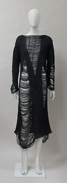This dress by Yohji Yamamoto dates back to spring/summer 1993. It is made of all cotton. Sheer fabric and garments were huge in the 1990s. Yohji's early work 'obscured the body in layers of unstructured garments', in distressed fabrics. He loved the color black because his mom wore it a lot.