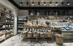 piso mármore, estantes aço, cestas, spots