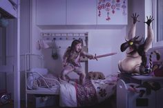 Salome fights a monster with a 'sword' in her bedroom in Laure Fauvel's 'Terreurs', 2014, in Paris, France. Click through for more.