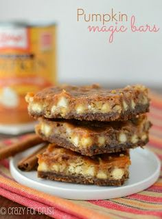 Pumpkin Magic Bars is a 7 layer bar you can make with pumpkin puree; a magic bar made with gingersnap crust, white chocolate, coconut and lots of pumpkin! Fall Desserts, Just Desserts, Delicious Desserts, Dessert Recipes, Halloween Desserts, Dessert Healthy, Cookie Recipes, Yummy Food, Pumpkin Bars