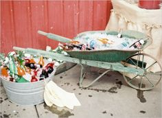 a groom favorite! vintage wheelbarrow filled with ice to keep drinks cold #farmwedding #oregonwedding #weddingchicks http://www.weddingchicks.com/2014/01/13/summertime-country-wedding/