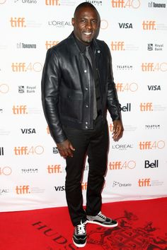 Attending the Beasts of No Nation premiere during the 2015 Toronto International Film Festival .