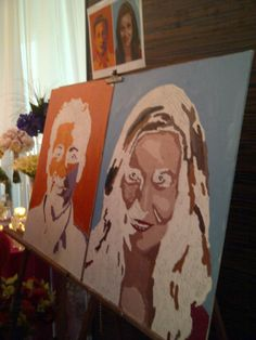 guests paint giant caricature of couple