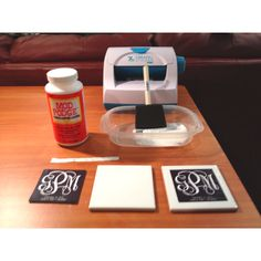 """DIY Wedding Favors: 4""""x4"""" (100mm x 100mm) Xyron Sticker Maker Mod Podge 3"""" wide foam brush Personalized monogram Clear silicone drawer stoppers (4 per coaster)  1. Print monogram 2. Feed through sticker maker. 3. Peel off and place on center of coaster. 4. Apply thin layer of Mod Podge. 5. Let dry. 6. Apply plastic stopper to each corner of underside tile. 7. Pour a glass of wine and enjoy!"""