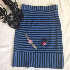 Stripes skirt in blue Mini skirt in black and blue with stripes with back zipper  .  100% polyester . Also available in yellow and black .Measurements lying flat .                                                Size Medium -waist :13, length 21                    size large waist :14, length 21 Skirts Midi