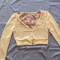 Crop sweater/cardigan Long sleeve, cropped style, detailed picture of back included, only worn once but still in great condition! I love this but I never wear it so that's why I'm selling☹ must be hand washed! Delia's Jackets & Coats