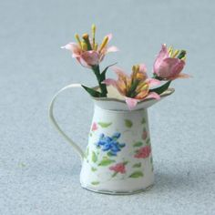 Dolls house scale lilies arranged in a printable miniature jug. - Photo copyright 2009 Lesley Shepherd, Licensed to About.com Inc.