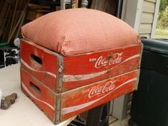 Repurposed Coke crates turned into a foot stool.  I can store a Coke blanket I have inside for later usage.