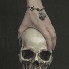 more ideas for her tarot cards. It could show her hand around a skull like this…