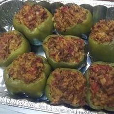 Baked Stuffed Peppers Preheat oven to 350 degrees F (175 degrees C). Stir cheese into ground beef-rice mixture and spoon mixture into precooked peppers. Set peppers upright in an 8x8-inch baking dish. Bake in the preheated oven until cheese is melted and the peppers are tender, about 30 minutes.