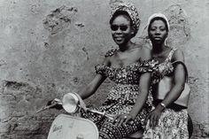 Seydou Keita's 2 African ladies on a Vespa.