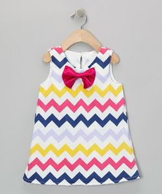 Jazzed with colorful zigzags and a satiny bow accent, this marvelously mod dress comes with soft cotton and a half-zipper in back for easy dressing.