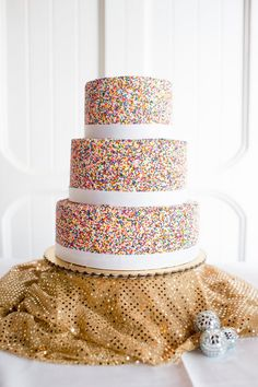 Colorful sprinkle wedding cake | photo by Ariane Moshayedi Photography | Read more - http://www.100layercake.com/blog/?p=67732