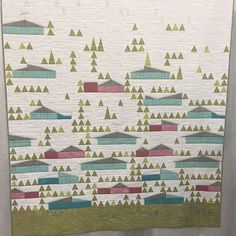 First place winner of the EZ Triangle Challenge at Quiltcon – Eichler Homes quilt pieced by Mickey Beebe and quilted by Tami Levin of the Quilted Lemon.