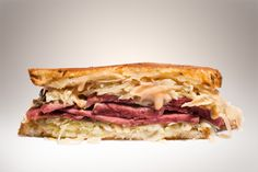 Reuben Sandwich     •3 tablespoons Thousand Island Dressing   •2 (1/2-inch-thick) slices rye bread   •1 1/2 ounces sliced Gruyère or Swiss cheese   •1 cup sauerkraut, drained and squeezed of excess moisture   •4 (1/4-inch-thick) slices pastrami or corned beef (about 4 ounces)   •1 tablespoon unsalted butter, softened