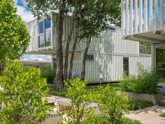 AHMM unveils shipping-container housing development in Oklahoma: Squirrel Park is a scheme of four houses made from converted once-used steel in Oklahoma City, USA, by Allford Hall Monaghan Morris. Converted Shipping Containers, Shipping Container Buildings, Shipping Container Homes, Container Houses, Surface Drainage, Horse Trough, Metal Siding, Zaha Hadid Architects, Affordable Housing