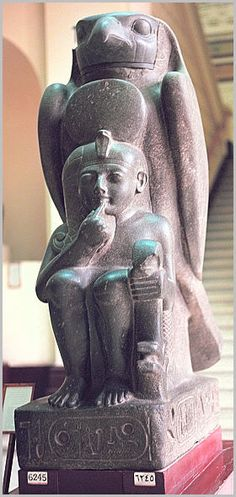 Colossal Statue of Ramesses II as a Boy, with a Falcon- Egypt  'non-bloodline' lineage features carried down to new puppet kings controlled by priesthood from behind the veil