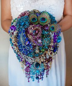 Peacock Wedding Brooch bouquet / http://www.deerpearlflowers.com/bling-brooch-wedding-bouquets/