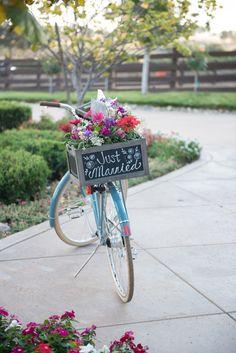 Cute signage! Love the bike. View the full wedding here: http://thedailywedding.com/2016/07/15/winery-bike-wedding-teresa-aaron/