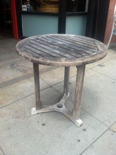 This vintage teak bistro table was handcrafted in Manassas, Virginia by Kingsley Bate Furniture Co.