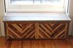 Built in window seat/bench made from salvaged wood. Chevrons made from old lath boards.