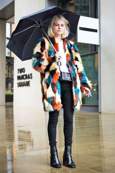 Team a basic tee and skinnies with a colorful patchwork-print faux fur jacket.