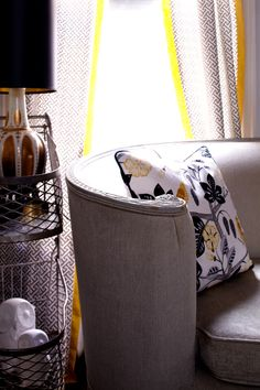 """Sneak Peek: P.J. Mehaffey and Dylan Hightower. """"Detail shot of the salon sofa, vintage grocery cart turned side table and the patterned drapes. I  had the drapes and pillow made from Waverly fabrics that I got from fabric.com, which is one the best and cheapest fabric sources around."""" #sneakpeek"""