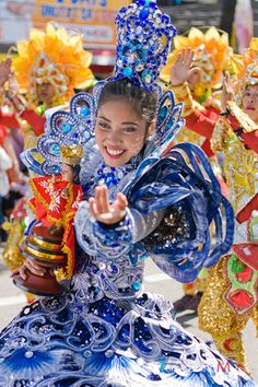 The Sinulog festival is one of the grandest and most colorful festivals in the Philippines. The main festival is held each year on the third Sunday of January in Cebu City to honor the Santo Niño, or the child Jesus, who used to be the patron saint of the province of Cebu (since in the Catholic faith Jesus is not a saint, but God). It is essentially a dance ritual which remembers the Filipino people's pagan past and their acceptance of Christianity. Photo: Festival Queen holding a Sto. Nino