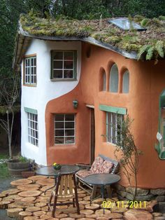 Wonderful cob home with living roof - INSPIRATION! Also LOVE the patio flooring - clever! :)