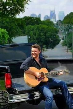 Chris Young, in the back of a pickup truck, playing guitar... What ain't perfect bout this picture?