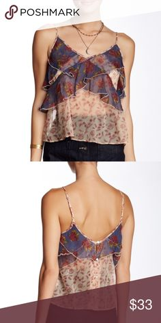 "Free People Top V-neck. Back partial button closure. Sleeveless. Adjustable spaghetti straps. Ruffled popover upper. Allover print. Partially lined. Approx. 23"" length. Shell: 100% viscose. Lining: 100% rayon Free People Tops"