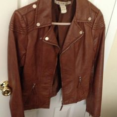 REDUCED Brown Pleather jacket Was $35 Now $20.                  Bronze/brown pleather jacket adds finishing touch to any outfit for a casual date night or to dress down a fancy look. Fun zipper on sleeves Jackets & Coats