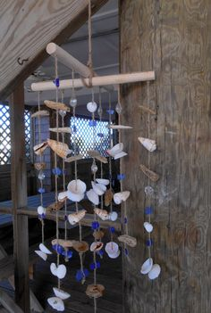 Wind Chime inspiration. Made with shells, driftwood and seaglass pieces. By searchnrescue2.