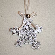 Make some fun decorations by turning a handful of unwanted puzzle pieces into glittering snowflakes! These look great hanging in windows.