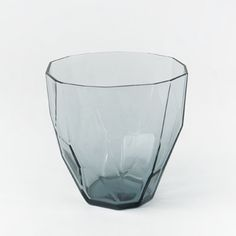 These generously sized tumblers feature an unusual faceted surface that recalls the beauty of natural crystals or cut stone, yet the transparency of glass keeps their appearance light and elegant. Made by the second oldest glassworks in Japan, the high quality glass is enlivened by gentle washes of soft color.