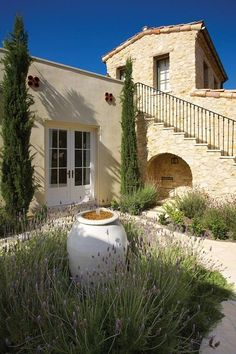 French Country - every Francophile should love this. Notice the hand made iron rails and white olive jar fountain. #homemadegardenfountains