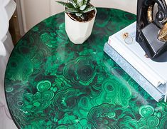 The Chicest (and Easiest) of DIY Furniture Projects (how to decoupage furniture) polyurethane coating finishes the fabric surface... I want that malachite fabric!