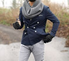 Navy blue cotton double breasted blazer, pocket square, scarf and grey jeans.