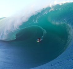 Keala Kennelly charging Teahupo'o.  2016 WSL Big Wave Awards Pure Scot Barrel Nominee