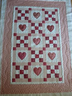 I ❤ quilting . . . Hearts Baby Quilt- A client's baby quilt. I longarm quilted this to accentuate the lovely applique. quiltsoflove.blogspot.com/2010/09/i-am-chipping-away-at-it... I can quilt for you too!... just email me msolomo1@maine.rr.com