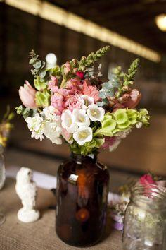 #centerpiece  Photography: Lauren Wakefield Photography - lauren-wakefield.com Flowers: Harvest Moon Flower Farm - harvestmoonflowerfarm.com  Read More: http://stylemepretty.com/2012/06/19/indianapolis-wedding-at-poplar-ridge-stables-by-lauren-wakefield-photography/