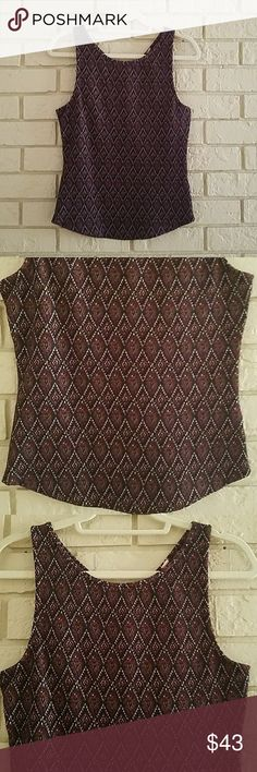 Free People Keyhole Back Fitted Tank EUC Worn Once Heavy weight material, beautiful colors, sad it won't fit anymore. Only reason I'm selling! Burgundy, black, white, and gold all woven into the diamond shaped pattern. Free People Tops Tank Tops